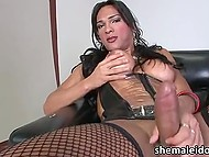 Brazilian t-girl Jo Garcia in erotic outfit strokes solid fuckstick and makes it ejaculate 4