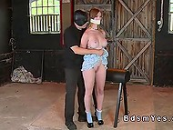 Busty milkmaid didn't prevent pervert from pushing panties in her mouth and warming up ginger pussy 4
