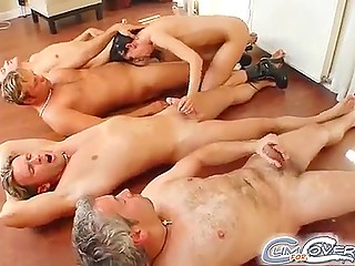 Black-haired whore shows off cocksucking skills making comrades' weapons cum with greedy mouth