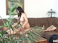 Camera manages to record how haired man fucks Asian MILF even through indoor plant