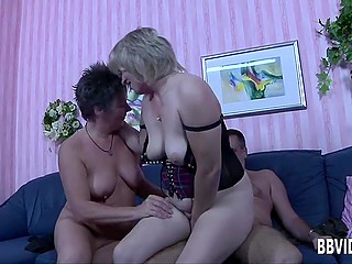 Mature women are unstoppable when it comes to empty haired comrade's balls in threesome