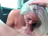 On the back seat of his cab, guy is having fun with the blonde MILF with natural tits 4