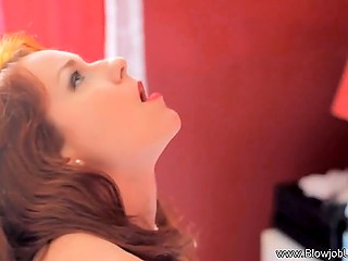 Red-haired lady in black lingerie reaches the peak of pleasure playing the clitar in bed