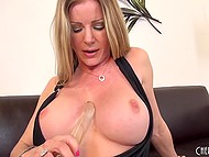 Big-tittied MILF rubbed smooth cunny with panties, fingers, and glass dildo to get maximum pleasure 5