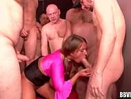 German MILF of easy virtue with big hooters is surrounded by cocks and has to handle them 11