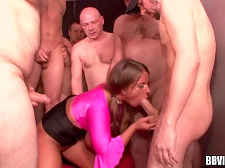 German MILF of easy virtue with big hooters is surrounded by cocks and has to handle them