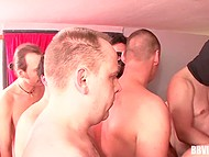 German MILF of easy virtue with big hooters is surrounded by cocks and has to handle them 4
