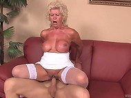 Blonde granny in white stockings still remembers her youth and is having fun with her lover on the sofa