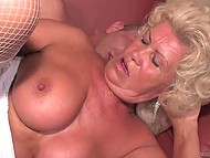 Blonde granny in white stockings still remembers her youth and is having fun with her lover on the sofa 7