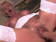 Blonde granny in white stockings still remembers her youth and is having fun with her lover on the sofa 9