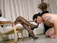 Elegant mistress reads magazine and forces masked man to lick and sniff high-heeled shoes 4