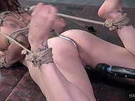 Tied redhead finds extreme enjoyment in getting her feet slapped and pussy worked with toys 8