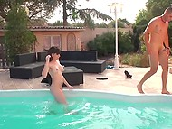 Guy and his horny girlfriends have a good time by the poolside filming on camera their sex 9