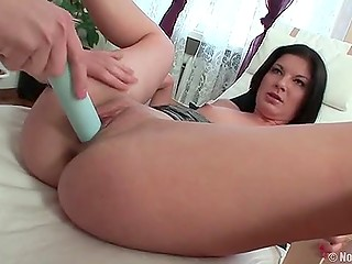 Playful brunette pines away from loneliness and has to use dildo but is helped by guy in time