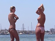 Young girls sunbath and swim without bras and don't notice man recording them 8