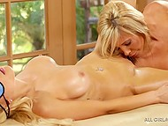 Busty master Tasha Reign showed blonde-haired babe her massage and pussylicking skills