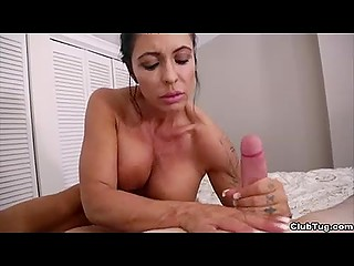 Big-tittied madam not only looks awesome but also strokes fuckstick as goddess of handjob