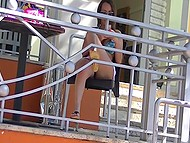 Minx in miniskirt takes off swimming trunks and flashes twat drinking coffee on the terrace 3
