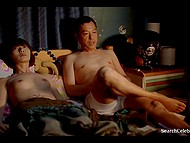 Fragment from movie where Asian girl as a sex doll makes everything that men want