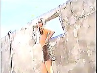 Busty Croatian poses in white lingerie and leopard outfit and gives blowjob to operator in ruined building 3