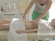 Pale-skinned teen slowly undressed and laid down on the massage table awaiting for complete relaxation 4