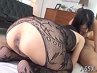 Asian in black lace bodystocking together with naked girlfriend suck phallus and nuts 3