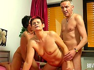 German threesome action with participation of married couple and mature woman with tinted hair