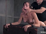 Debauched men chained petite babe and roughly fucked her from both sides in the basement 7