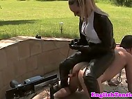 Drilldos penetrates chained man's anus and mouth and mistress in leather boots enjoys this scene 10