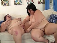 Two gorgeous BBW chicks uncover their gigantic boobs and give each other a nice pussy licking