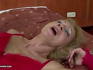 Old woman in red lingerie was playing with sex toy when black man joined and fucked her anal hole 11