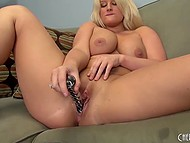 Gorgeous blonde exposes her outstanding boobs and penetrates hungry pussy with a dildo