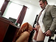 As soon as curly boy left the office, red-haired secretary got out from under the table and sucked boss' dick