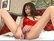 Petite Japanese Hikaru Aoyama puts on red lingerie and has fun with vibrating toy