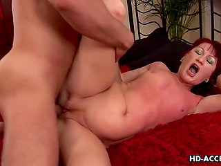 Hard-working fucker forced red-haired mature lady to moan loudly during severe fuck
