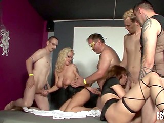 Men leisurely fuck chesty blonde together with slutty lady in the German video
