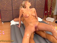 Pretty masseuse oiled young visitor then paid special attention to his hard cock 5