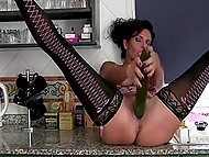 Housemaid in seductive lingerie prepared huge fresh cucumber but not for vegetable salad