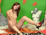 Smiling good-time girl in high heels carefully stimulates smooth vagina alone 3