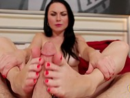 POV handjob video with brunette babe that uses her hands and feet to relax guy 10