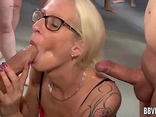 Blonde-haired mature with glasses sucked men's cocks and paid special attention to three guys