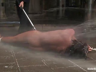 Tied Ebony girl gets poured with water in hard way and her wet pussy gets stimulated with vibrator