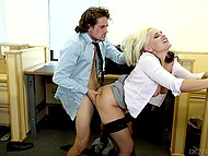 Busty lady in stockings wants some rest so she seduces curly-haired dude that bangs her in the office