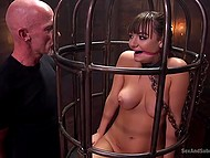 Bald man locked pretty girl in cage and tried to bring pussy unusual feelings