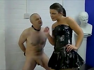 Merciless mistress in latex dress hits submissive slave's balls to the blood in femdom session