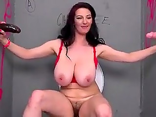 MILF with enormous hooters was excited when huge black and white rods protruded through gloryhole