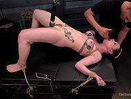 Tied brunette receives unforgettable pleasure while tasting hard cock in torture chamber