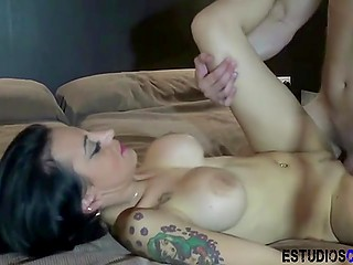 Big-breasted brunette with tattooed body received sperm mask for servicing hard penis