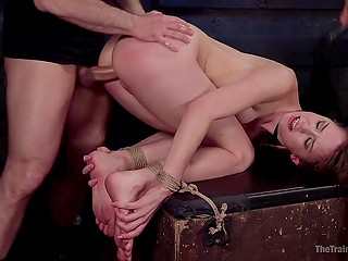 Pervert properly tied up good-looking babe and actively screwed her in doggystyle position in basement