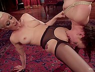 Innocent babe is hooked upside down and has to lick pussy of severe mistress